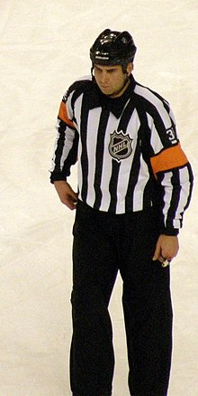 A man wearing a striped shirt with orange armbands 2e74ffbd929