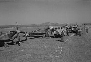 No. 73 Squadron RAF - Spitfire Mark IXs of No. 73 Squadron RAF, undergo servicing and refuelling at Prkos, Yugoslavia 1945