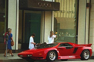 Rodeo Drive - A Vector W8 parked in front of the Gucci store