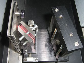 Attenuated total reflectance - An ATR attachment for infrared spectroscopy. The sample is in the steel containers either side of the pink crystal
