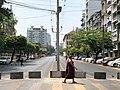 A Monk Walking by Bogyoke Road Yangon.jpg