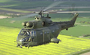 A Royal Air Force Puma helicopter over the English countryside