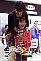 A Special Olympian and her mother celebrate after the girl bowled a spare at the Strike Zone in Iwakuni, Japan, Oct 111016-M-GU681-213.jpg