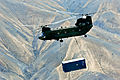 A U.S. Army CH-47 Chinook helicopter carries a sling-loaded shipping container during retrograde operations and base closures in the Wardak province of Afghanistan 131026-A-SM524-737.jpg