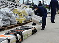 A U.S. Coast Guardsman assigned to the medium endurance cutter USCGC Legare (WMEC 912) stacks a bale of cocaine seized as part of Operation Martillo at Coast Guard Base Miami Beach, Fla., Sept 140904-G-ZK759-880.jpg