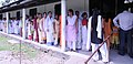 A large number of voters waiting in a queue to cast their votes, at a polling booth under the Tezpur constituency for the 1st phase of Assam Assembly Election, at Tezpur, on April 04, 2011.jpg