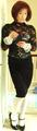 A sissy cross dresser in feminine office wear.png
