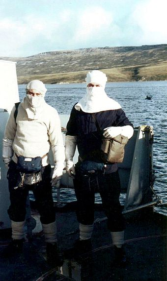 British sailors in anti-flash gear at action stations on HMS Cardiff near San Carlos, June 1982 Action stations Falklands 1982.JPG