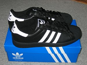 Adidas Superstar - A pair of Adidas Superstar, with a black color and 3 white stripes.