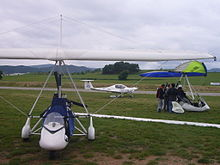 Aerosport airshow 2011 two ultralights and a small airplane.JPG