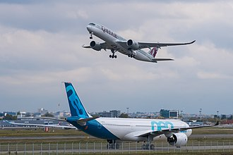 Airbus - An Airbus A330neo and a Qatar Airways Airbus A350-900 at Toulouse-Blagnac Airport