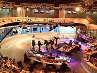 The English studio being used with presenter at the desk