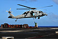 An MH-60S Knight Hawk helicopter transports cargo from the flight deck of aircraft carrier USS Carl Vinson (CVN 70) during a vertical replenishment at sea in the Pacific Ocean Dec. 19, 2011 111219-N-ZI635-216.jpg