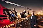 Andi Siebenhofer in front of helicopters (that were delivered by his company) in Erbil, Kurdistan, Iraq.jpg