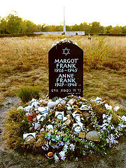 Memorial for Anne and Margot Frank at the former Bergen-Belsen site, along with floral and pictorial tributes.