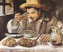 Portrait d'un homme attablé et mangeant des fèves.