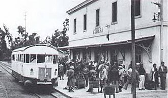 Italian East Africa - Asmara station on the Eritrean Railway in 1938, with passengers boarding a Littorina