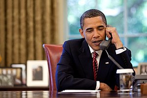 President Barack Obamaa talks on the telephone...