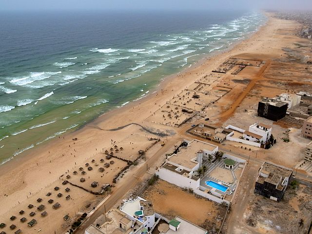 Beach front in Senegal By Jeff Attaway from Abuja, Nigeria (beach front  Uploaded by AlbertHerring) [CC-BY-2.0 (https://creativecommons.org/licenses/by/2.0)], via Wikimedia Commons