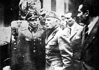 Death of Benito Mussolini - Mussolini abandoning the Prefecture in Milan on 25 April 1945. Believed to be the last photo of him alive.