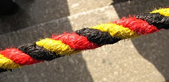 National colours of Germany - Black, Red and Gold barrier cord at the German Bundestag parliament