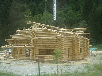 Log house moulder - A log home under construction
