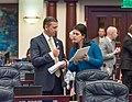 Bob Rommel and Ana Maria Rodriguez confer on the House floor.jpg
