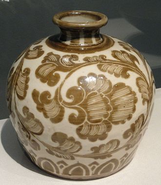 Ding ware - Song Dynasty Ding porcelain bottle with iron pigment under a transparent ivory-toned glaze, c. 1100.  Both the closed shape and the painted underglaze decoration are uncommon in Ding.