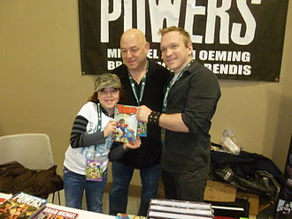 Brian Michael Bendis - Brian Michael Bendis with his daughter Olivia and artist Mike Oeming in March 2011.
