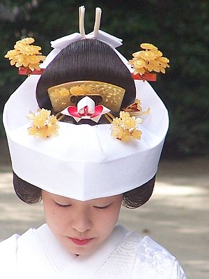 Shinto wedding - A bride at a Shinto wedding shows her wig and tsuno-kakushi headdress.