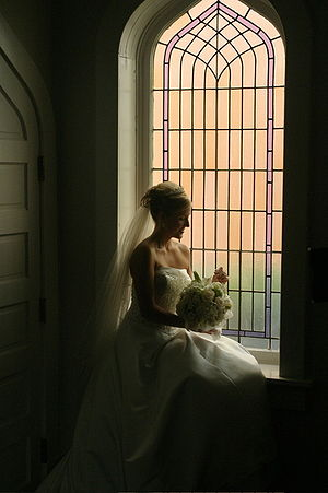 Cathedral glass - Bride sitting in front of a window of cathedral glass. Photo, Nils Fretwurst, 2005