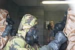 British forces practice CBRN procedures in a US Army Facility 150226-A-BD610-050.jpg