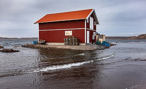 Picture of a red building surrounded by flood water