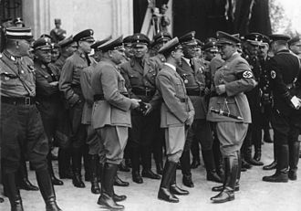 Franz Xaver Schwarz - Nuremberg Rally 1936. Hermann Göring is talking with Joseph Goebbels and Franz Xaver Schwarz. To the left of Goebbels is Robert Ley, who along with Göring, was charged at the Nuremberg War Crimes Trials with crimes against humanity.