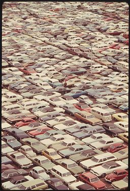 CARS WERE JAMMED INTO EVERY SPARE SPACE AT A DOWNTOWN COMMERCIAL PARKING LOT DURING A BUS STRIKE IN WASHINGTON... - NARA - 556721