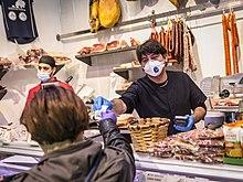 https://upload.wikimedia.org/wikipedia/commons/thumb/3/36/COVID-19_Iruñean_-_Cerca_de_casa,_la_vuelta_del_pequeño_comercio_13.jpg/220px-COVID-19_Iruñean_-_Cerca_de_casa,_la_vuelta_del_pequeño_comercio_13.jpg