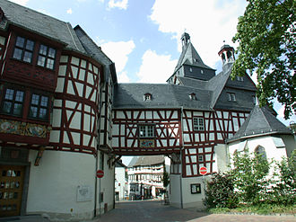 Bad Camberg - Southeast façade of the Amthof with the upper tower's cupola in the background and the apse of the Hohenfeldkapelle at the right edge of the picture