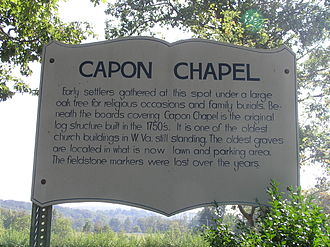 Capon Chapel - The wooden historical marker located near the west side. While it claims that construction occurred in the 1750s, existing documentation supports a construction date of around 1852.