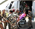 Casualties brought from Lamabagar to Kathmandu by an Indian Air Force (IAF) Mi-17 V5, being received by the Indian Paramedical team, post a recent massive earthquake occurred in Nepal on May 13, 2015.jpg