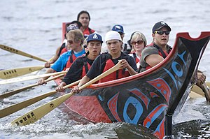 Teslin Tlingit Council - Traditional Tlingit canoe being raced during events at the 2009 Ha Kus Teyea Celebration, Teslin Lake, Teslin, Yukon