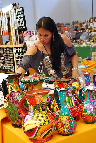 Mexican ceramics - Woman selling pottery items at the Feria de Texcoco, Texcoco, Mexico State