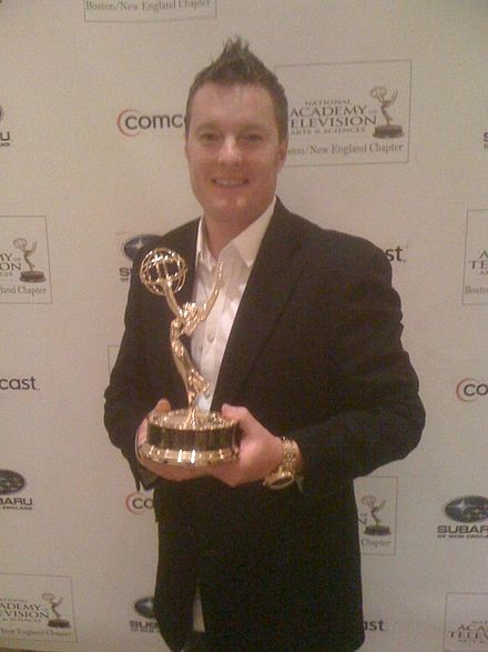 New England sports personality Charlie Moore holding a New England Emmy Award in 2011 Charlie Moore with Emmy Award.JPG