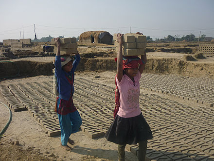 Thousands of children work as bonded labourers in Asia, particularly in the Indian subcontinent. Child labour Nepal.jpg