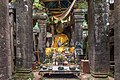 Clothed statues of the Buddha in the ruined Khmer Hindu temple of Wat Phou, Champasak, Laos.jpg