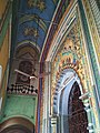 Colorful floral designs and geometrical patterns along with traditional arches enhances the doors of the temple.jpg