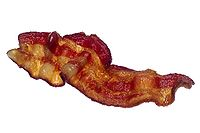 A strip of cooked bacon