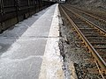 Crumbling platform edge at Newtonville, March 2013.JPG