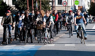 Urban cyclists in Copenhagen in Denmark at a traffic light Cyclists at red 2.jpg