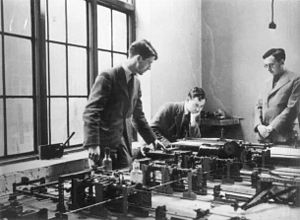 Differential analyser - MOTAT's Meccano differential analyser in use at the Cambridge University Mathematics Laboratory, c. 1937. The person on the right is Dr Maurice Wilkes, who was in charge of it at the time