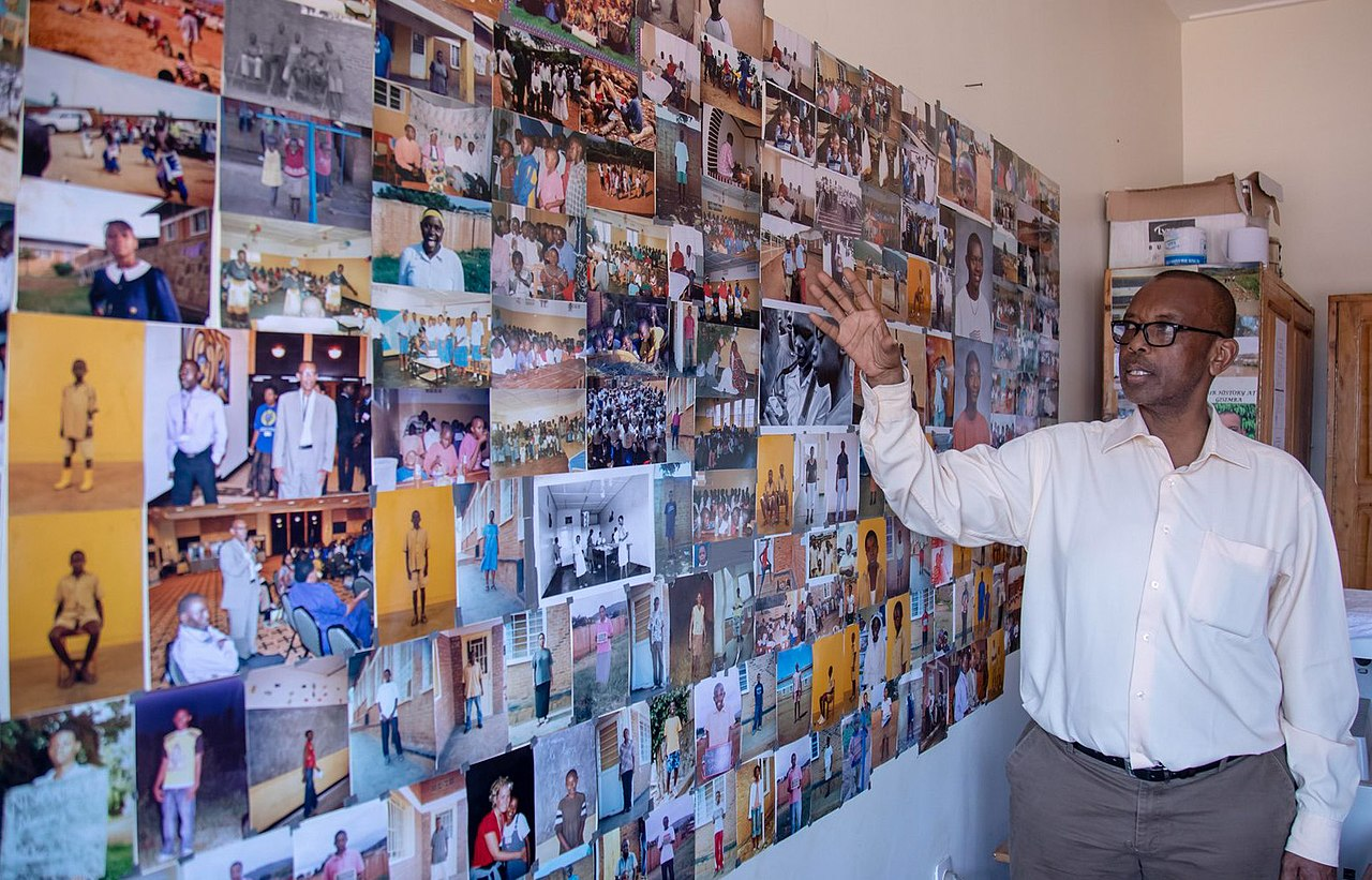 Damas Gisimba Mutezintare, the Director of the Gisimba Memorial Centre shows photos of around 325 children who were rescued during the 1994 Genocide against the Tutsi in Kigali on April 16, 2019. Emmanuel Kwizera.jpg
